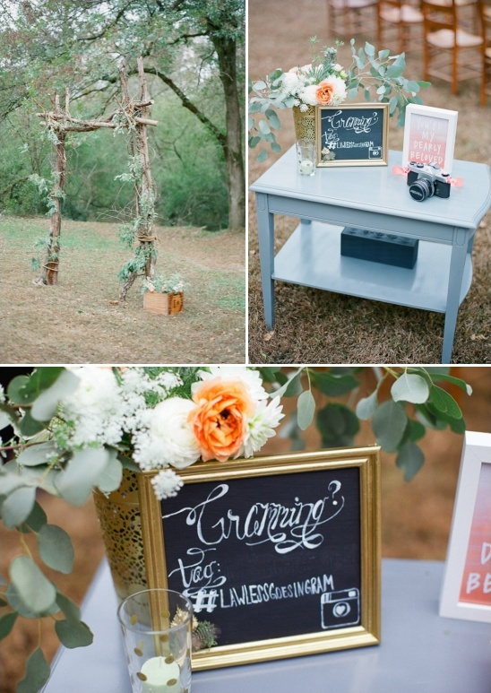 rustic arch and instagram welcome table