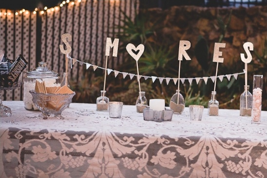 smores tables with gold cut letters
