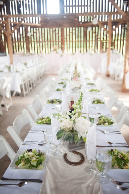 swanky dinner party in a rustic barn setting