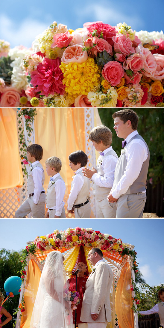 bright floral covered wedding arch