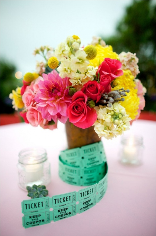 brightly colored florals and carnival ticket centerpiece