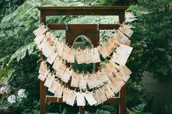 escort cards hung along vintage door