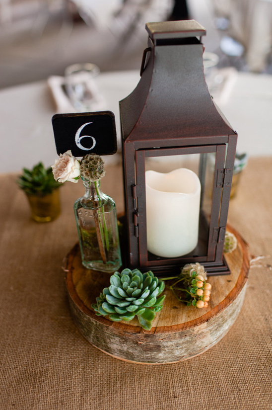 candle lit lantern centerpiece and table number