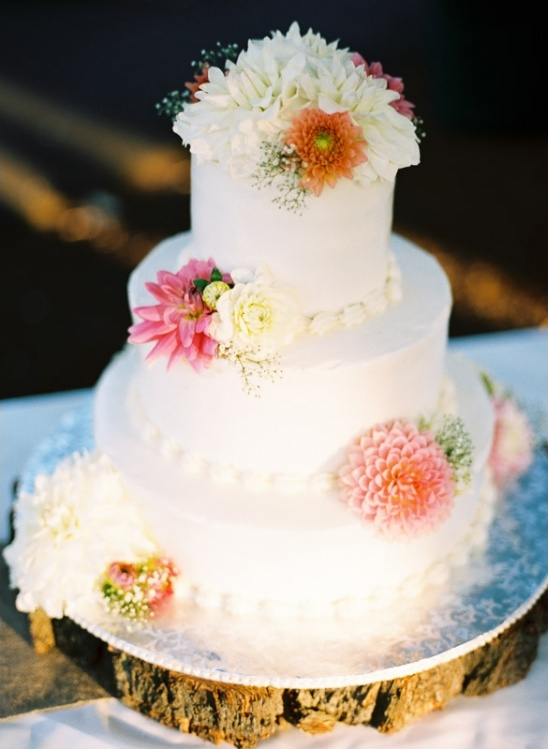 white wedding cake topped with florals