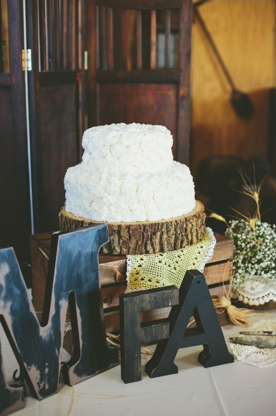 rustic rose cake on a stump cake stand