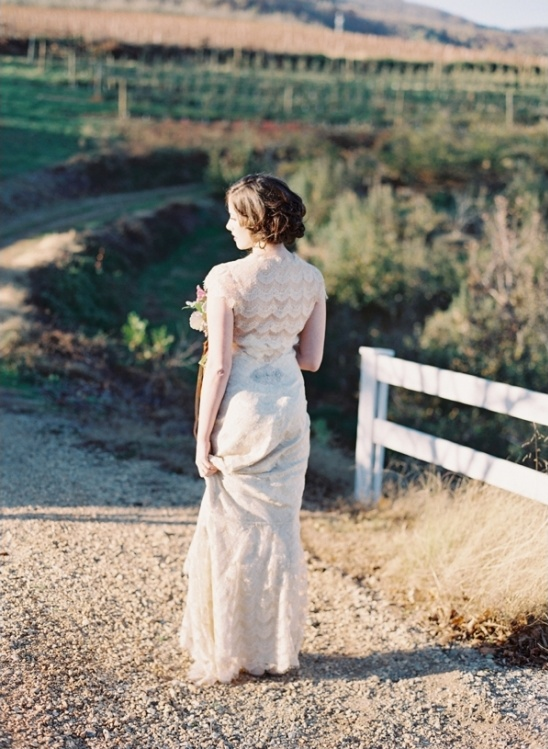 tiered lace wedding dress by Claire Pettibone