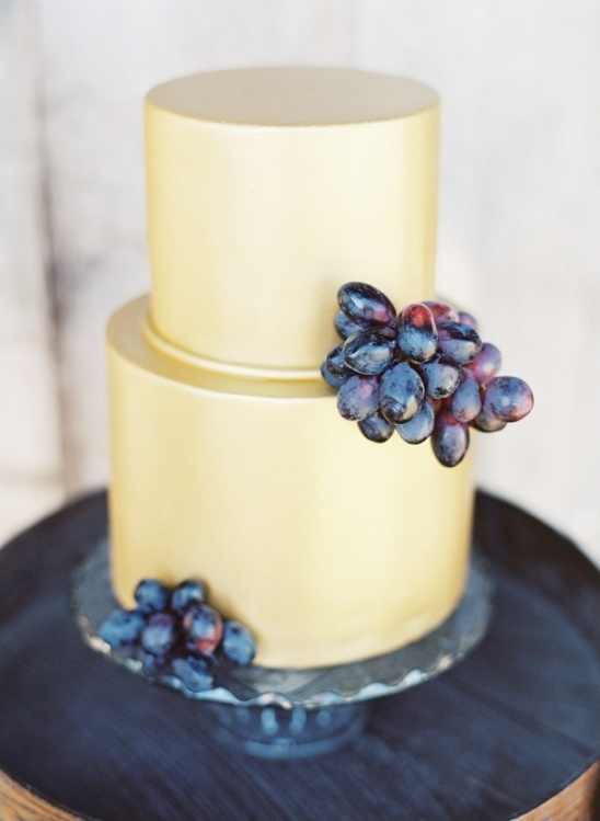 elegant wedding cake with grape garnishes