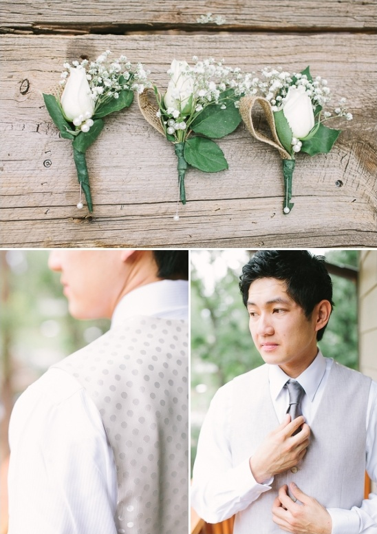 white rose boutonnieres and cream colored groom attire
