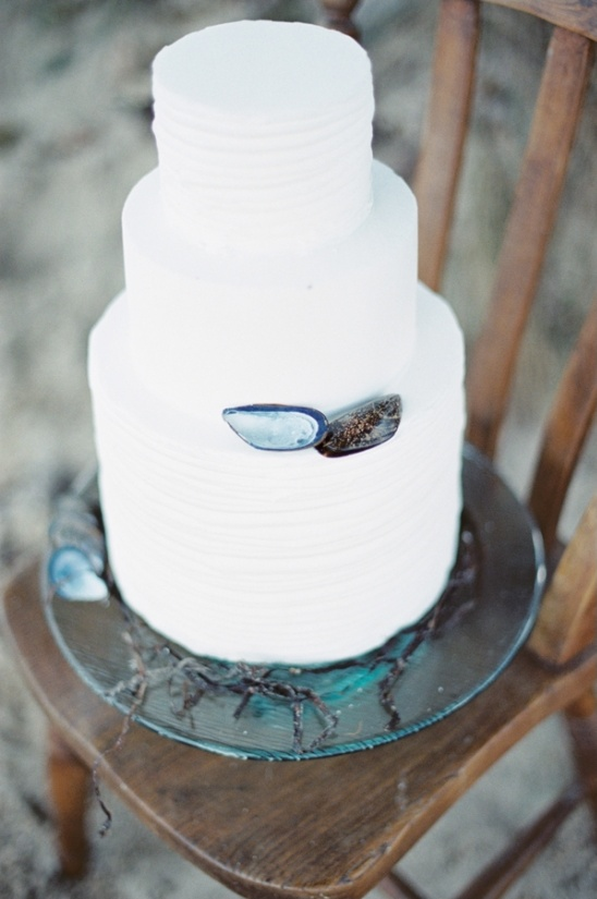 simple white cake with mussel shell accent