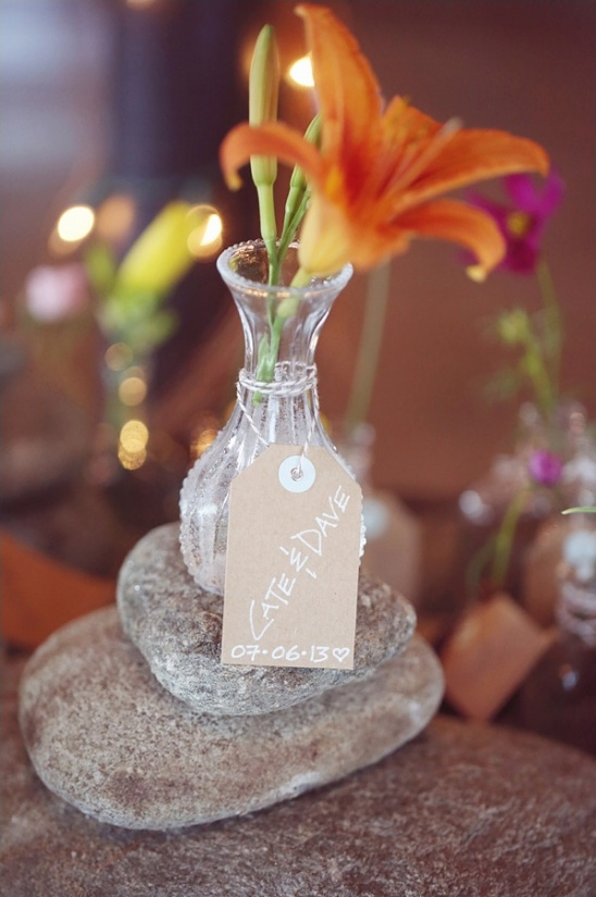 flowers and vase wedding favor doubles as an escort card