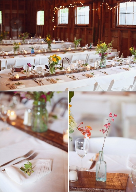 family style table setting with simple floral centerpieces