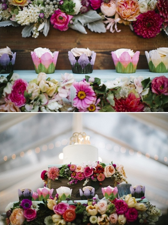 flower inspired cupcakes and towering wedding cake