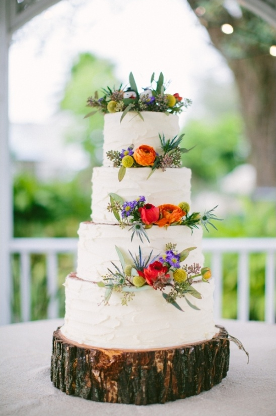 beautiful white wedding cake with floral decor