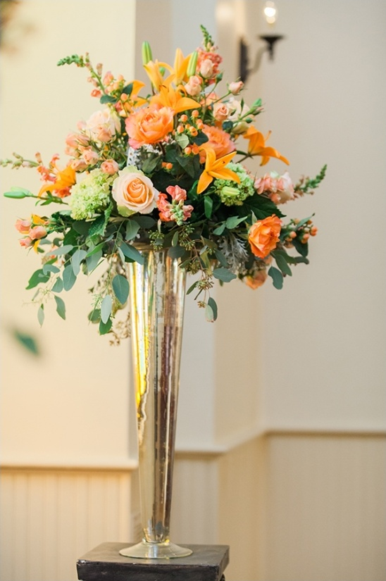 bright orange ceremony floral decor