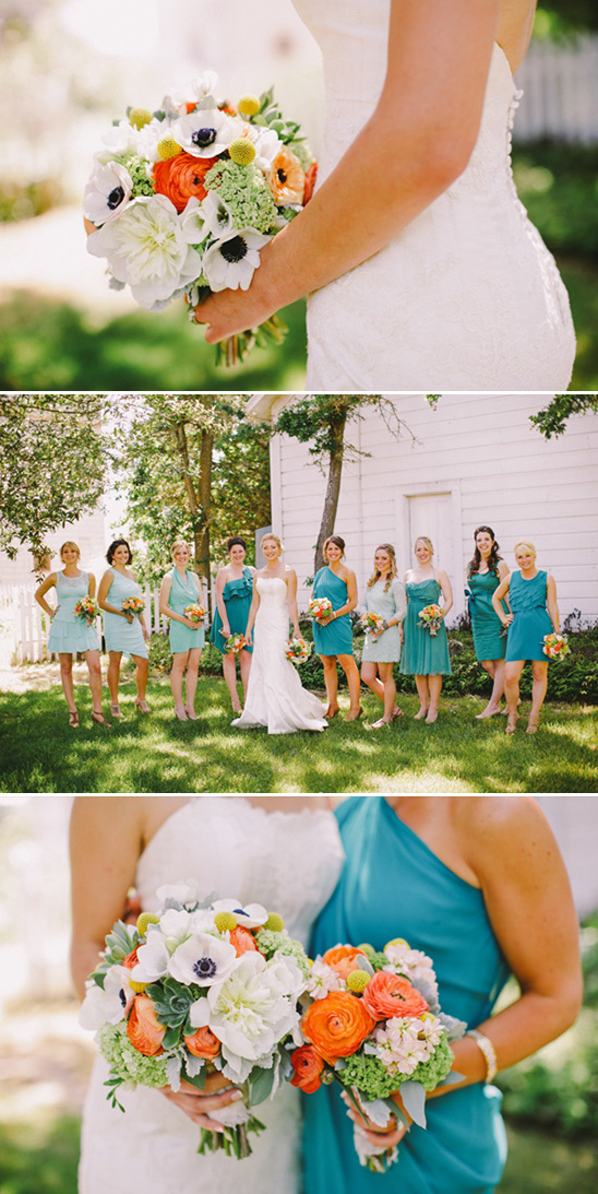 orange and white bouquets with verying teal bridesmaid dresses