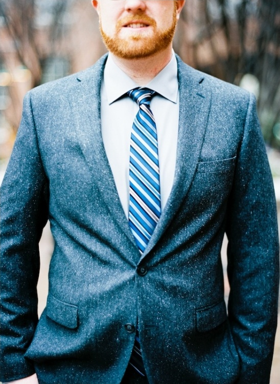tweed jacket and blue tie groom look