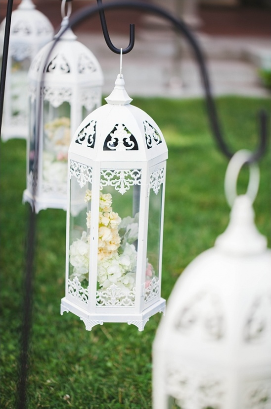 flower filled lantern aisle decor