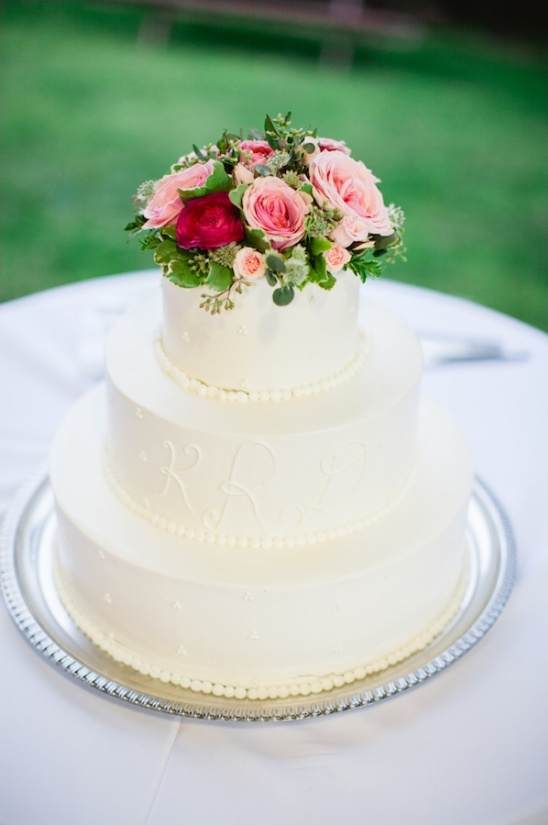 white wedding cake with pink florals