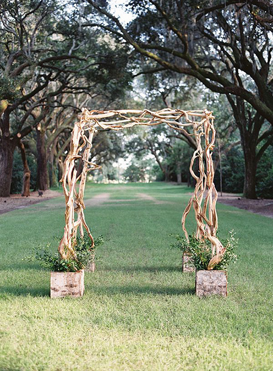 simple twisted wood wedding arch