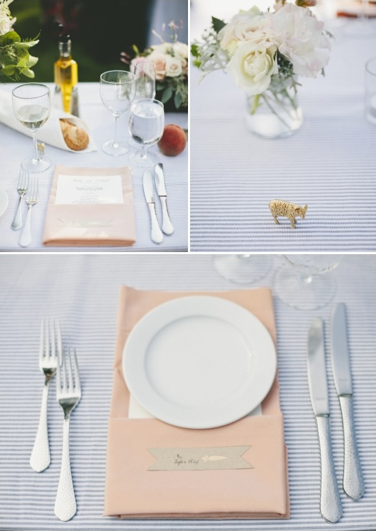 peach table settings on blue pinstripe tablecloth