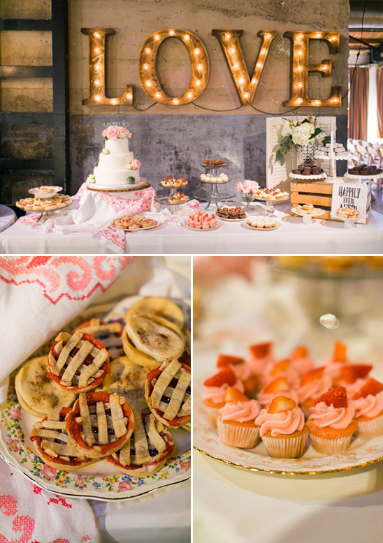 dessert table with marquee love sign