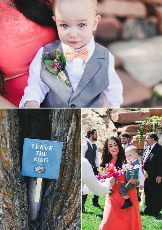 little bow tied ring bearer and a I have the ring sign