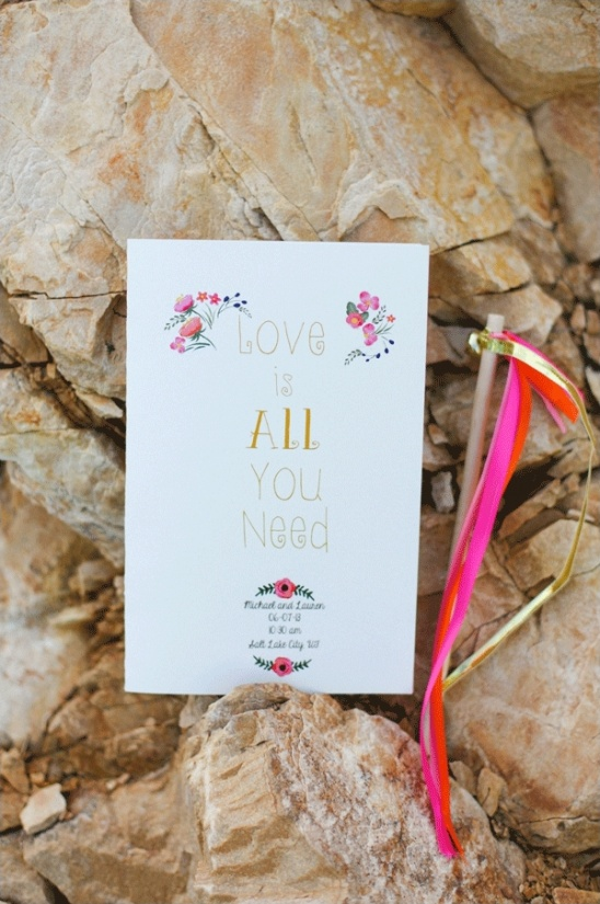 love is all you need wedding program and streamer