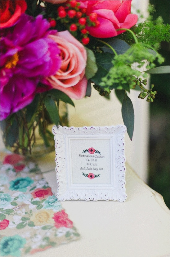 cross stiched wedding date sign
