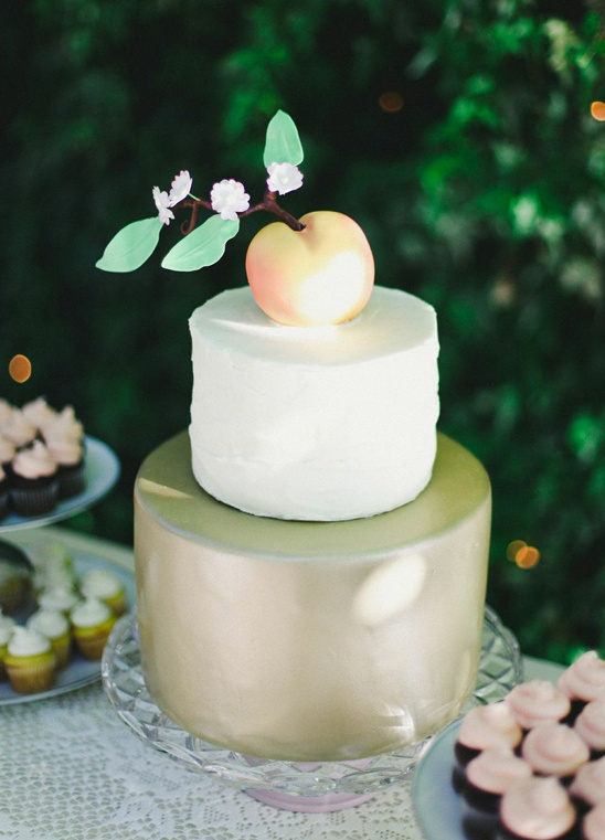 peach topped wedding cake