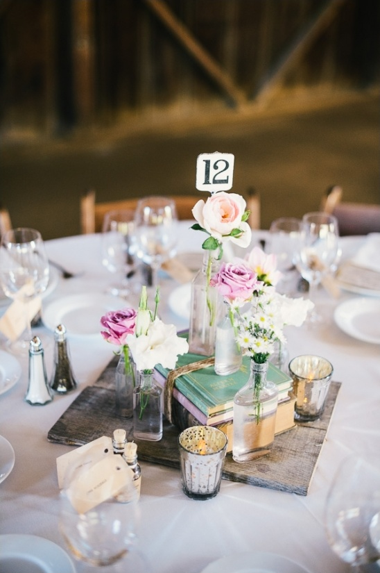 floral pieces and book combination for centerpieces