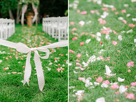 rose petal covered ceremony aisle