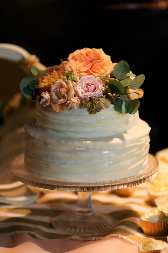 white wedding cake with peach floral toppers