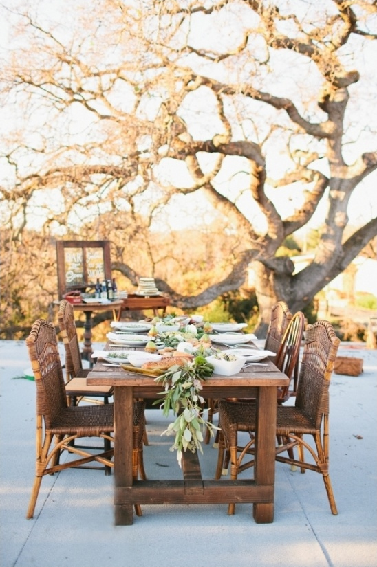 wicker chairs and wooden table reception ideas