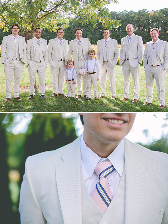 beige suit with pink and navy tie for the groom and his men