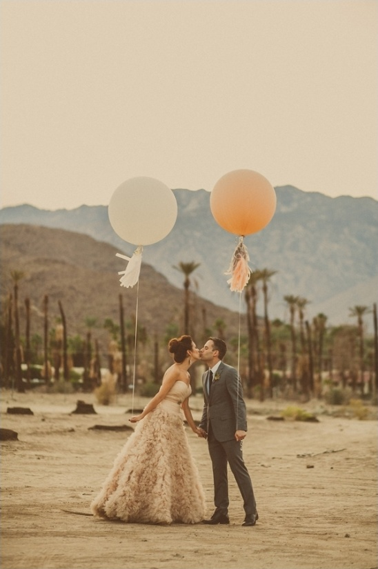 giant balloons and a wedding kiss captured by Yuna Leonard