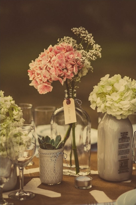 collected glass jars used as centerpieces