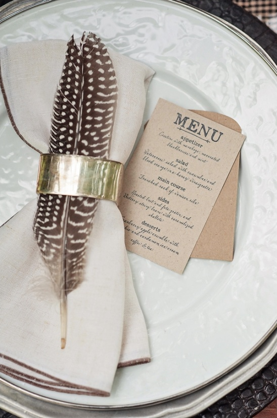feather in a napkin ring holder