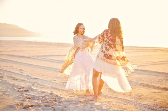 bride and bridesmaid twirling in kimonos
