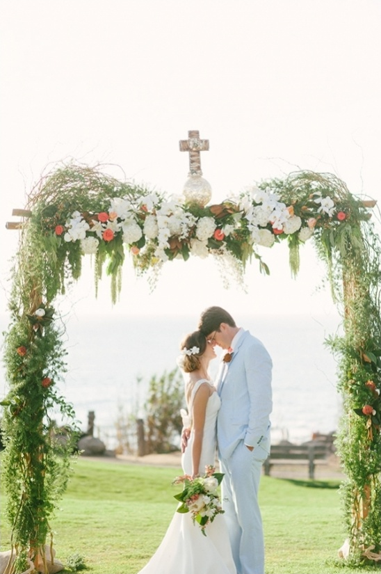 floral and vine covered wedding ceremony arch