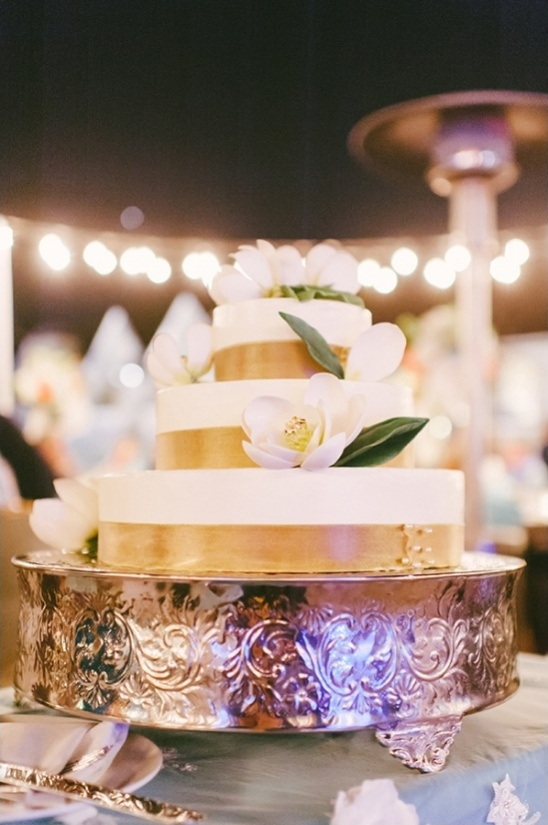 gold ribbon wrapped wedding cake
