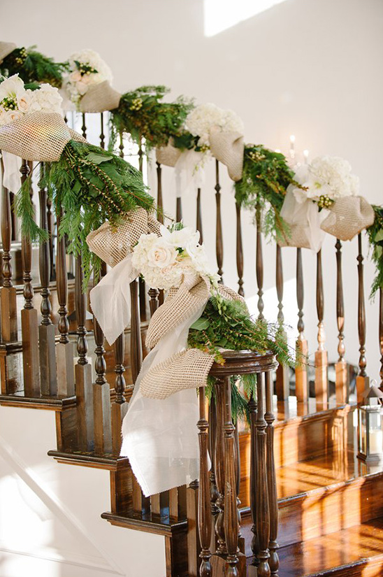 floral and burlap decorated wedding staircase