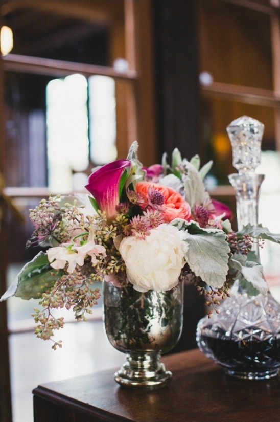 pink and white centerpiece in a mercury glass vase