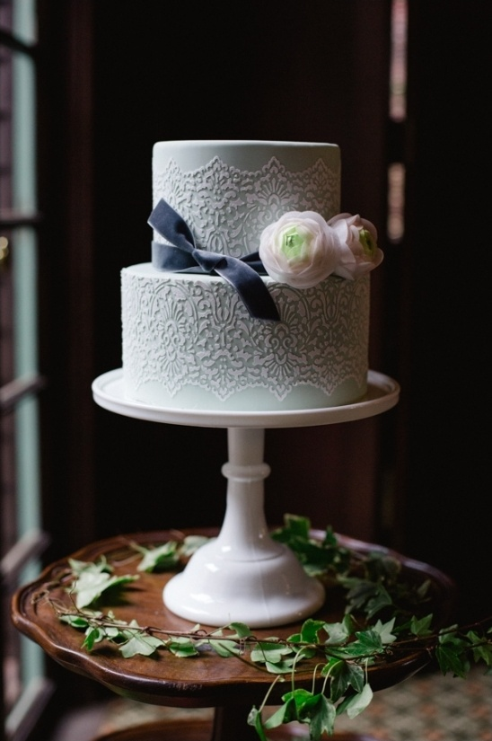 mint cake with delicate lace accents and tied with a velvet ribbon