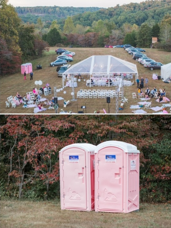 pink outhouses at outdoor wedding reception