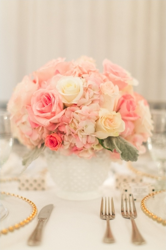 white and pink milk glass floral centerpiece
