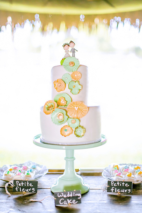 orange and mint wedding cake with custom topper