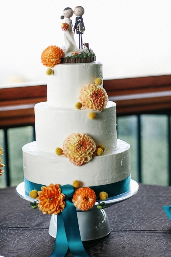 orange and teal wedding cake