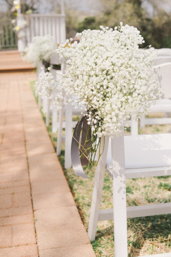 babys breath hanging from chairs