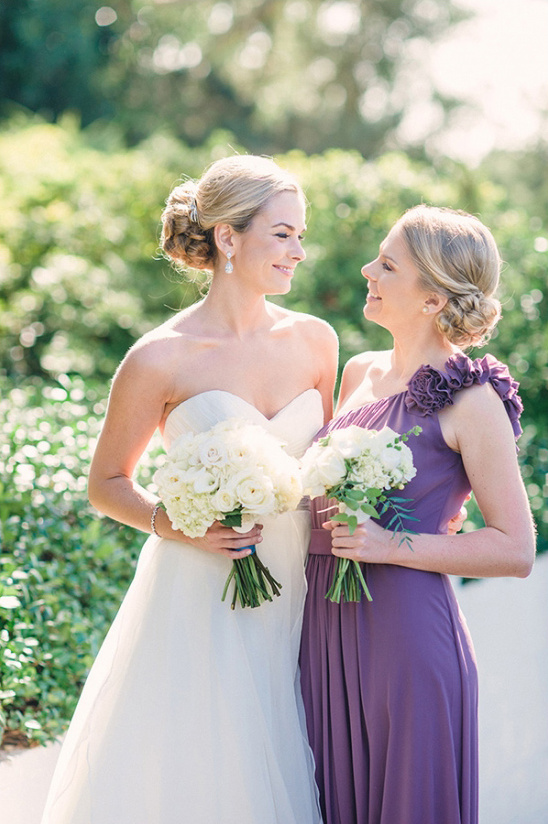 purple dresses and white bouquets