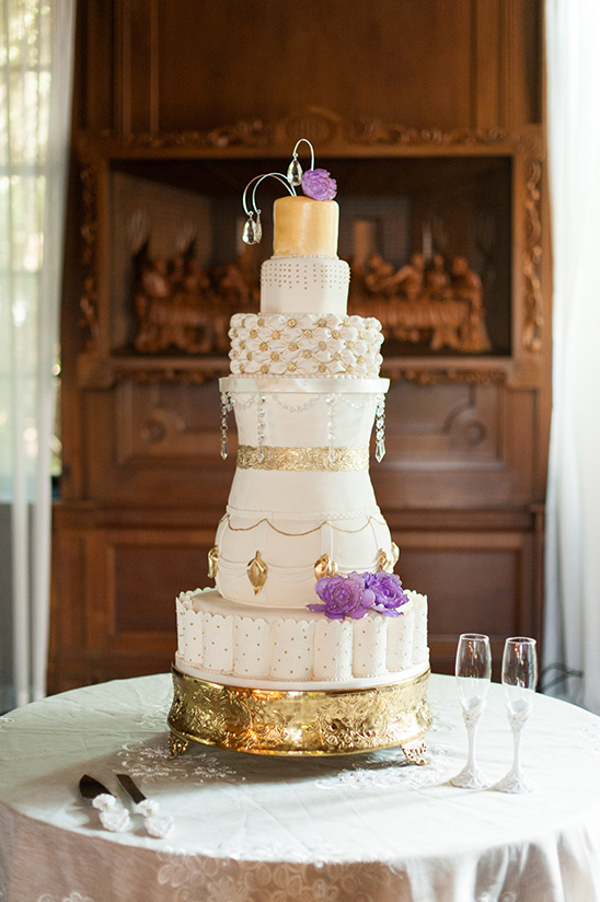 gold and purple regal wedding cake